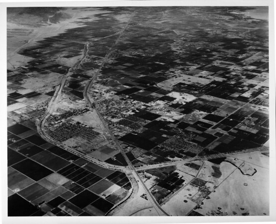 Aerial view of Indio, California, facing south by southeast, Route 111, Indio Boulevard, Indio High School, Indian Palms Country Club, County Center, fairgrounds, Date Festival