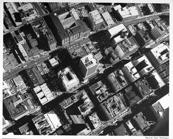 Close aerial view of downtown Los Angeles buildings looking south from Fifth Street and Spring Street