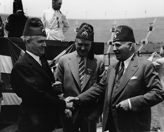 Shriner's shaking hands inside Los Angeles Coliseum