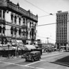 The corner of Seventh Street and Main Street showing the Robarts Building liquor store