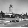 A corner view of the Beverly Hills City Hall with a row of cars parked in front of it