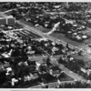 Aerial view facing northwest over Wilshire Boulevard, showing S. Rossmore Avenue, S. Muirfield Road (S-shaped), S. Rimpau Boulevard, and S. Hudson Avenue