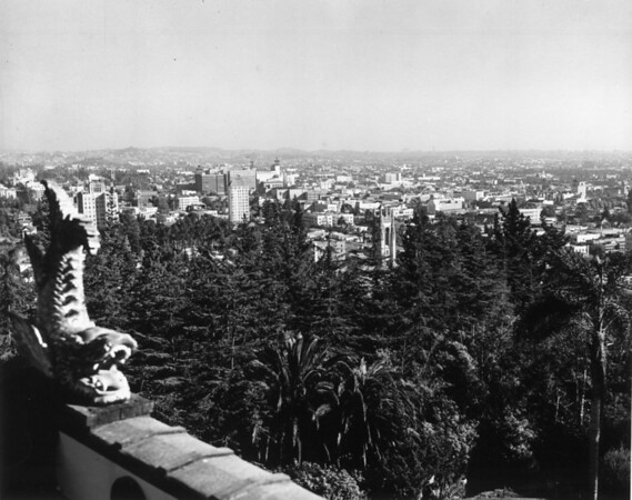 A high-angle view of the Japanese Gardens in Hollywood Franklin Park with the buildings of the city in the background