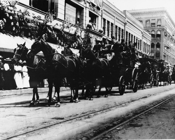 Shriner's parade, downtown on Broadway in front of Laughlin Building, horse and carriage
