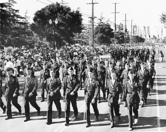 Uniformed veterans marching in the American Legion Parade