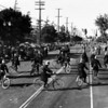 American Legion parade, comedic keystone cops on bicycles