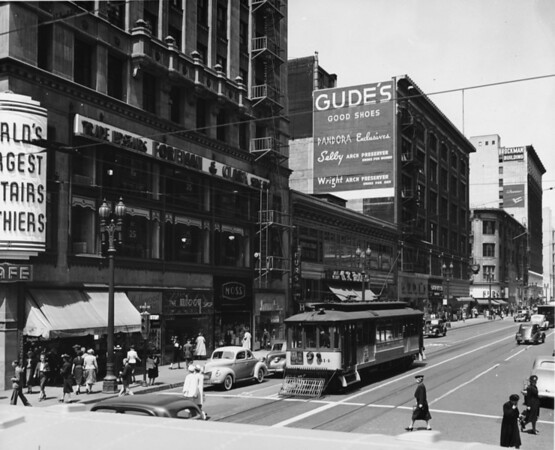Looking west on Seventh Street from Hill Street, showing Gude's shoe store, Foreman & Clark, and the Brockman Building