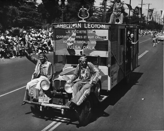 "American Legion parade, Long Beach, float featuring the American legion ""La Societe Des Quarante Hommes Et Huit Chevaux Voiture Locale 185"" from Tulsa"