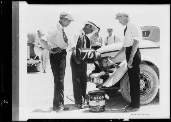 Earl Cooper, etc., with Auburn at dry lake, Southern California, 1932