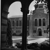 View of college library through arches on the University of California at Los Angeles (UCLA) Campus in Westwood