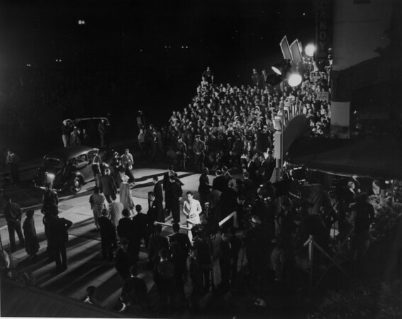 "A high-angle view from the side of the Fox Carthay Circle Theatre as people enter it during the premiere of ""Wee Willie Winkie"""