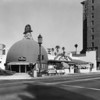 A view of The Brown Derby Restaurant seen from the corner of Wilshire Boulevard and Alexandria Avenue
