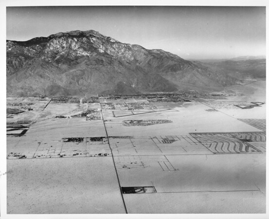 Aerial view of Palm Springs in background, Cathedral City in foreground. Ramon Road, Date Palm Drive, Palm Springs Regional Airport