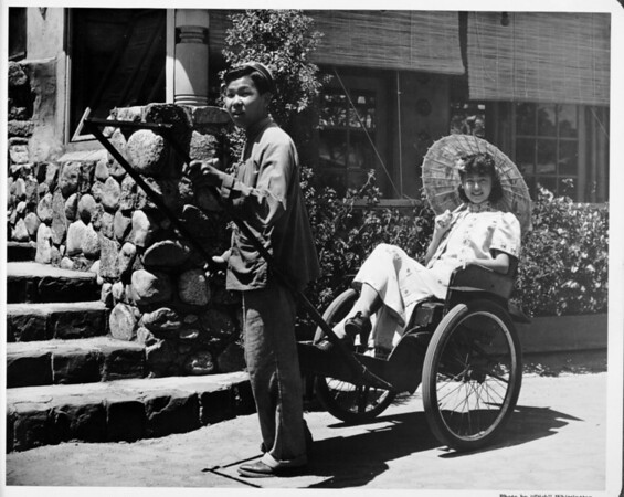 Getting a ricsha ride, Chinatown in 1948