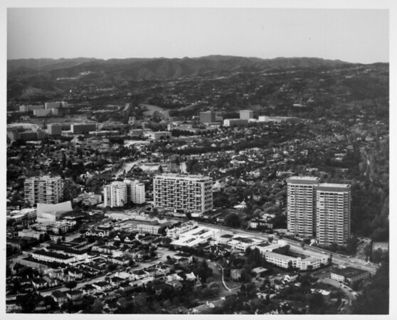 Aerial view facing north over Westwood at Wilshire Boulevard and Beverly Glen Boulevard. University of California at Los Angeles (UCLA), Bel-Air, and the Santa Monica Mountains are in the background