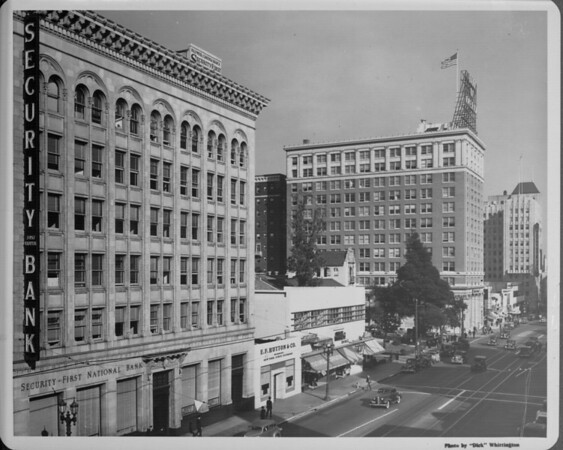 A high-angle view of the Security First National Bank along with a row of other buildings down Hollywood Boulevard
