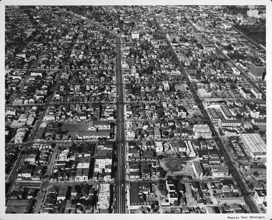 Westlake, Olympic Boulevard, aerial view looking east towards Alvarado, with the Southwest corner of MacArthur Park showing to the north