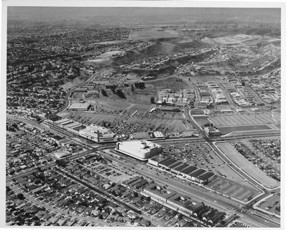 Aerial view of Crenshaw Boulevard facing south, Santa Babarbara Avenue, Crenshaw Mall with Baldwin Hills in the distance