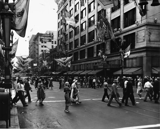 In Downtown Los Angeles facing south on South Broadway at West Fourth Street, the Broadway, and E.W. Reynolds Company in the Metropolitan Building at 315 West Fifth Street