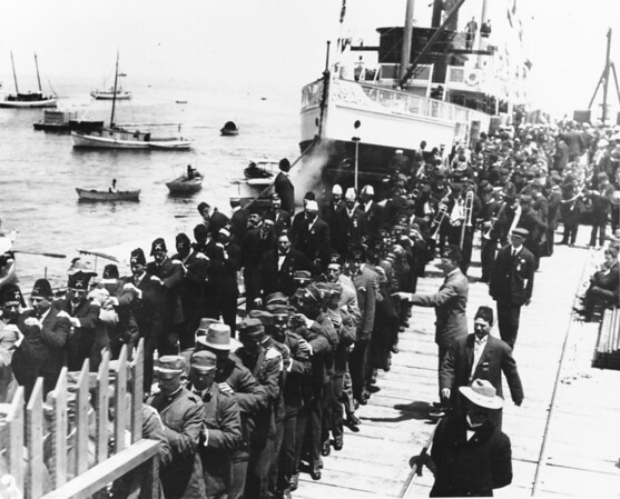 Shriners disembark Catalina Ferry at Avalon Bay forming lines on the dock