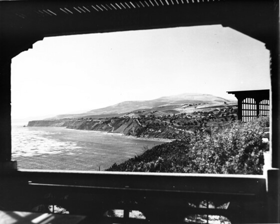 A view of the Southern California coast, with houses on the hills above the ocean
