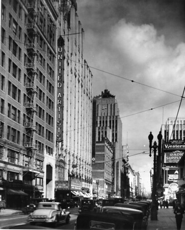 In Downtown Los Angeles on South Broadway with Texaco Building, United Artists Theater, and Eastern Columbia building at 849 South Broadway