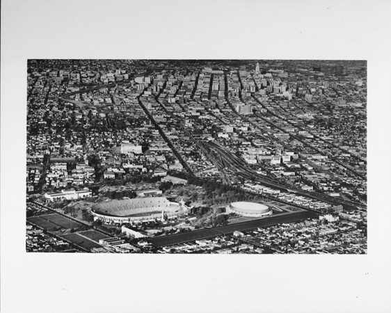 Aerial view, Exposition Park, Coliseum, Museum of Natural History, Sports Arena, looking northward into Downtown Los Angeles, City Hall, University of Southern California (USC)