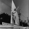 A woman on a sailboat in the American Legion Parade