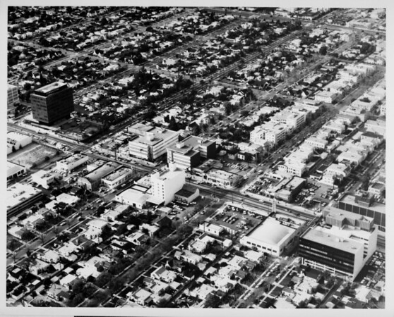Aerial view facing north over Wilshire Boulevard and Doheny Drive in Beverly Hills. Wetherly Drive, Almont Drive, La Peer Drive and Swall Drive are also in view