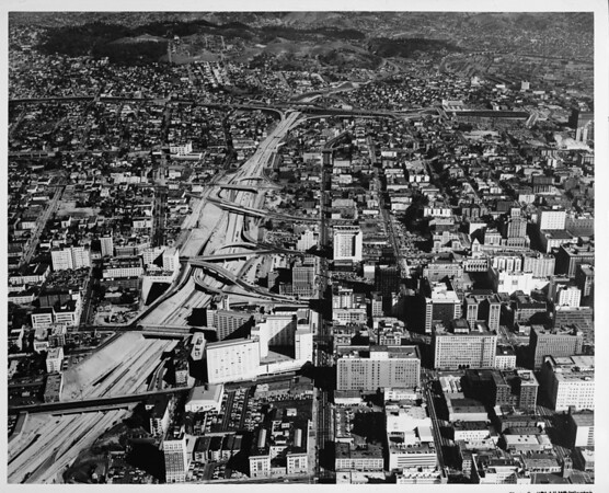 Aerial view (facing North) of Downtown Los Angeles, Harbor Freeway, Civic Center, future site of the Music Center, with US-101 in the distance