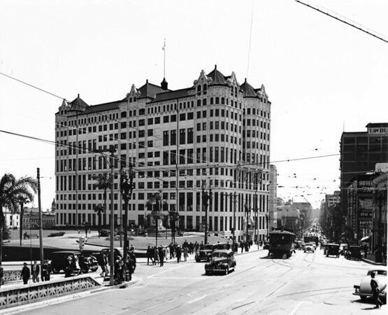 In Downtown Los Angeles facing south the corner of Temple Street and North Broadway at the old court house (where the new County Criminal Court House stands today)