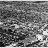 Aerial view facing northwest over Wilshire Boulevard and Fairfax Avenue. McCarthy Vista, Crescent Heights Boulevard, May Company