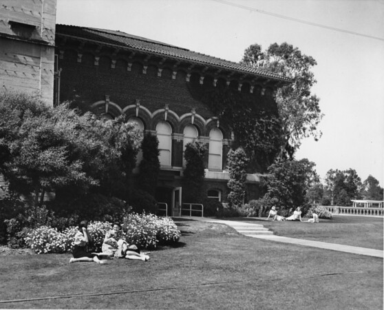 Students resting on the steps of a school building