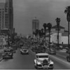 Facing west on Wilshire Boulevard from Hobart Boulevard past Steven's Quality Ice Creams, Jean Leonard Piano, Newberry's, the Wiltern Theater at Western Avenue