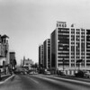 On Wilshire Boulevard facing east at Ardmore Avenue, the Tishman Building at 3440 Wilshire Boulevard, Walter N. Marks Realtor, Gaylord Apartments in the background