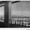A Spanish style porch overlooking downtown Los Angeles (including City Hall) in the distance