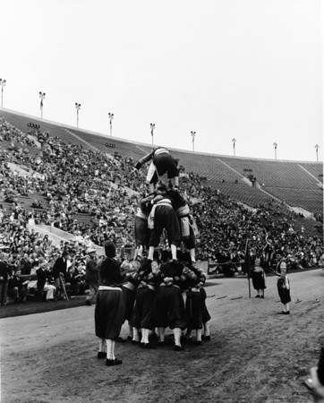 Shrine parade at Coliseum featuring human pyramid