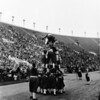 Shrine parade at Coliseum featuring human pyramid