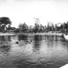 Photo looking across MacArthur Lake at the Elks Lodge and the Asbury Hotel