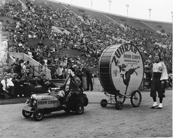 Shriner's parade inside Coliseum featuring clown and drum from Zuhrah Drum Corps, Minneapolis, Minnesota
