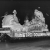 Shriner's night time parade at Coliseum, featuring Metro Goldwyn Mayer float