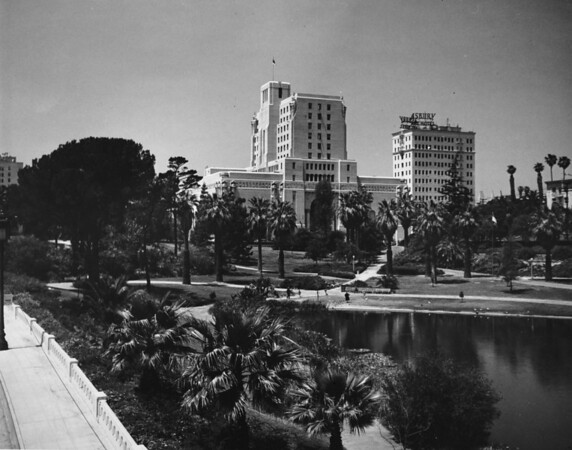 Westlake Park with its lake in the foreground and the Ashbury Hotel and the Elks Club in the background