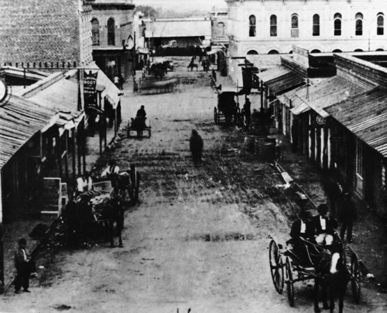 A commercial street with horses and carriages in Downtown Los Angeles
