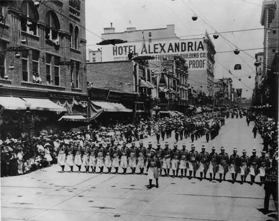 Moolah Patrol of Saint Louis on parade in Los Angeles, followed by marching band