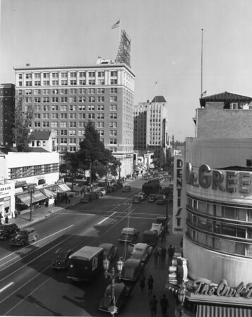 A high-angle view of Hollywood Boulevard from the intersection of Cahuenga Boulevard which foregrounds the Owl Drug Company