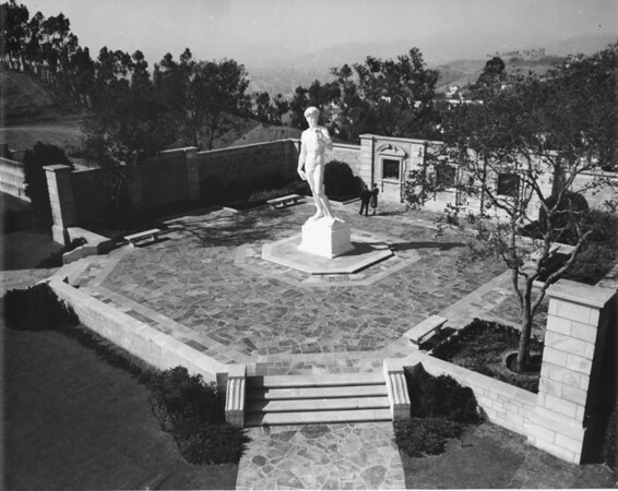 A high-angle shot of the Sculpture of David with the mountains in the background at the Forest Lawn Memorial Park
