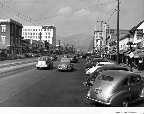 """Looking up a Glendale street toward the mountains, past the Glendale theater, which is advertising Bing Crosby and Martha Raye in """"Waikiki Wedding"""""""