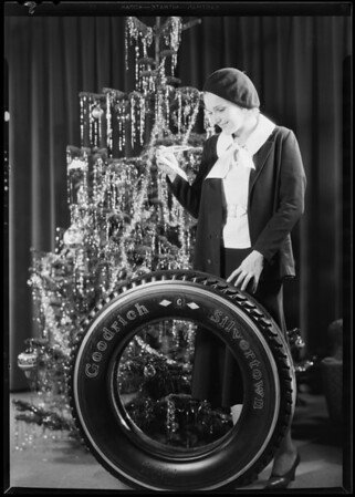 Christmas tree and tire with Lola Lane, Southern California, 1930