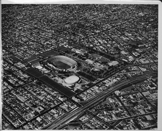 Aerial view overlooking Exposition Park, encircled by Vermont Avenue, Figueroa Street, Exposition Boulevard, and Martin Luther King Boulevard
