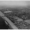 Aerial view facing north over El Porto, El Porto County Beach, Vista del Mar, Los Angeles International Airport in the background